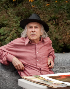 Outdoor photo of Donald C. Kelley with black hat/rec shirt.